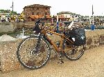 bamboo bicycle loaded with touring gear