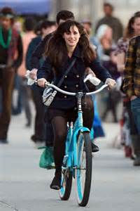 Zooey Deschanel bicycling