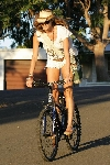 Elle MacPherson bicycling