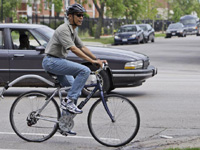 Barak Obama bicycling