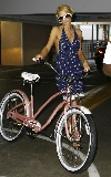 Paris Hilton bicycling
