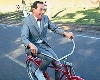 Paul Reubens, a.k.a. Pee-Wee Herman, bicycling