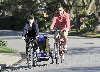Liev Schreiber and Naomi Watts bicycling