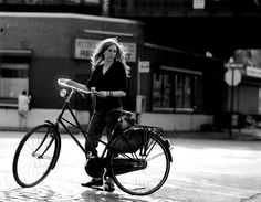 Patti Smith with a bicycle.