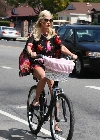 Tori Spelling bicycling