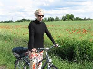 Tilda Swinton bicycling